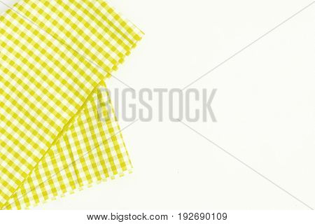 Yellow fabric, kitchen towel with checkered pattern, isolated on white background isolated.