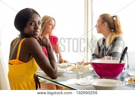 Three girls enjoying lunch together