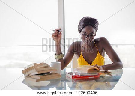 Pretty student reading a book
