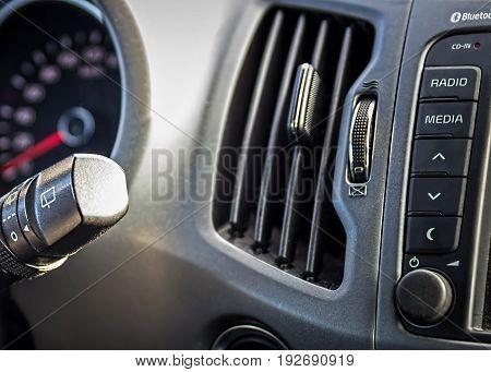 Wiper stalk. Car dashboard.  Auto inside. Car windscreen wiper handle.