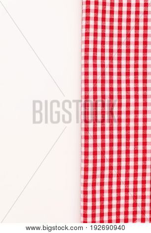 Red cloth, a kitchen towel with a checkered pattern, on a white background isolated.