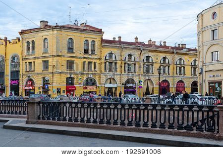 SAINT PETERSBURG RUSSIA - MAY 1 2017: Unknown people walk along embankment of Griboyedov Canal St. Petersburg Russia