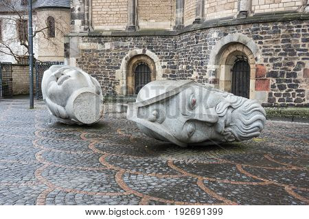 BONN, GERMANY - FEBRUARY 21, 2016: Sculptures depicting the heads of Saints Cassius and Florentius in front of the Bonn Minster Bonn Germany