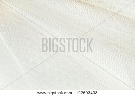 Diagonal folders of white wedding lace with floral pattern. Wedding background