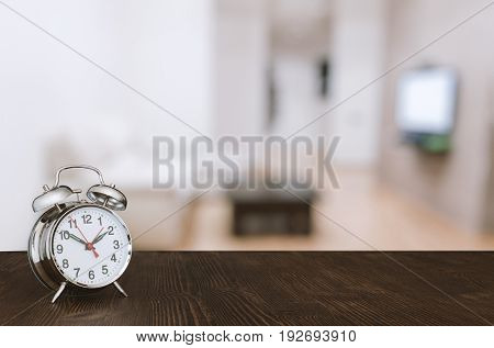 clock on wooden table in the living room