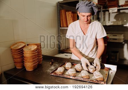 Proving dough of bran in basket. Private Bakery. Production bread. Workshop making