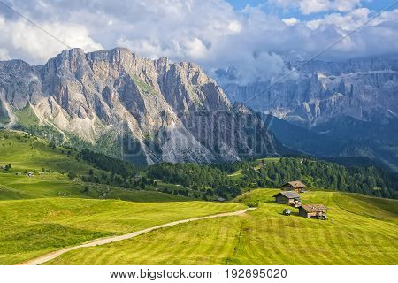 Scenic view of alpine pasturage in picturesque mountain valley Dolomites Italy