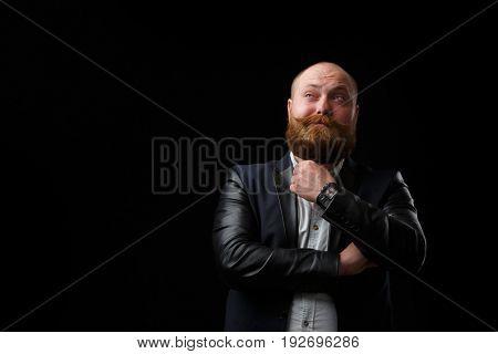 Pensive man with ginger beard