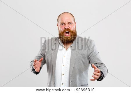Angry, dissatisfied man with beard