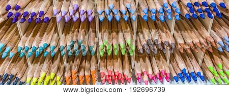 Wooden colored pencils on a shelf Colored Pencil Tips Colorful Spectrum Shelf Background Stacks Groups Rainbow