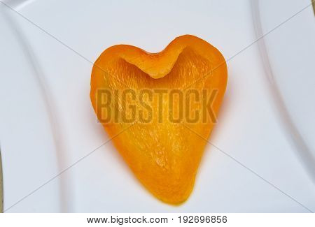 fresh orange peppers Orange pepper on a plate Pepper carved heart