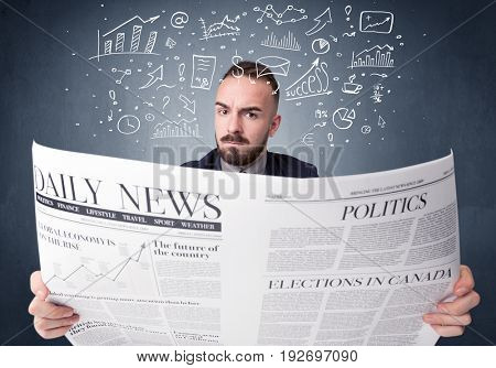 Young smart businessman reading daily newspaper with business plan graphics above his head