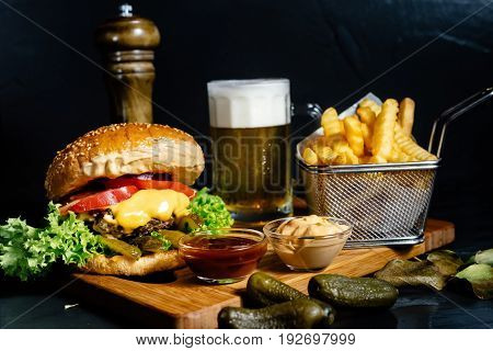 Mouth-watering Juicy Cheeseburger With Fries, Pickles, Beer And Coleslaw Salad Served By Bistro