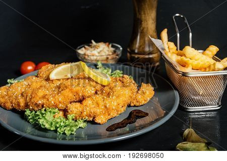 Fried Veal Chop As Stylish Wiener Schnitzel Served With French Fries And Vegetables