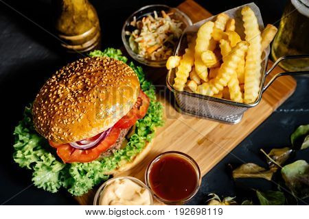 Tasty American Stylish Beef Burger With Grilled Meat And Mayo Served With Fries, Coleslaw And Beer