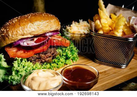 Tasty And Delicious Juicy Beef Burger, American Style Food With French Fries And Coleslaw Salad