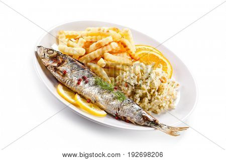 Fish dish - grilled trout with vegetables on white background
