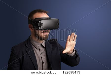 Amazed businessman with virtual reality goggles