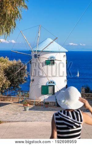 Woman Against Old Windmill On Zakynthos Island In Greece