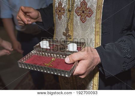 The priest holds church utensil glansceremony of water baptism various objects needed for baptism christening at Burgas