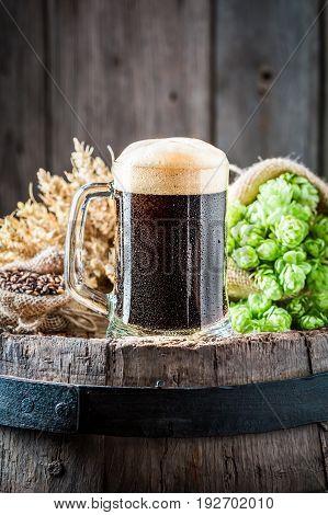 Pint Of Dark Beer On Old Oak Barrel