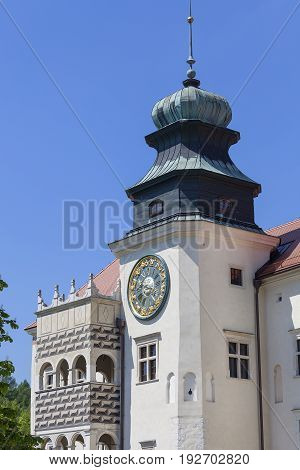 14th century defense Castle Pieskowa Skala clock tower near Krakow Poland. Located in Ojcowski National Park is one of the best-known examples of a defensive Polish Renaissance architecture