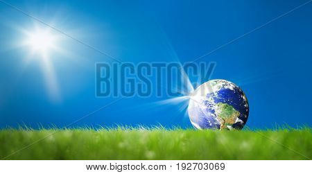 conceptual image of world on green landscape. NASA world map image layered and used;