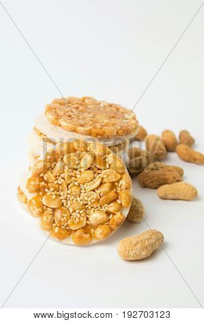 Sweet Cookies With Caramelized Peanuts On White