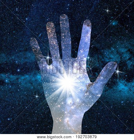 conceptual image of hand and abstract lights of universe. NASA galaxy images manipulated and used;