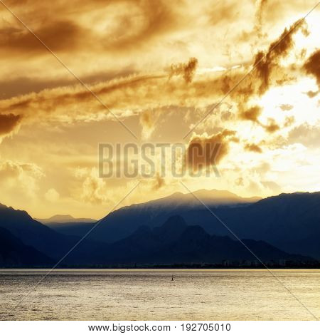 landscape image of high mountains over cloudy sunset sky in Antalya, Turkey