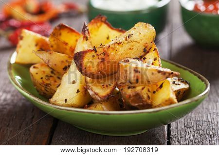 Spicy roasted potato wedges with ketchup and mayonnaise