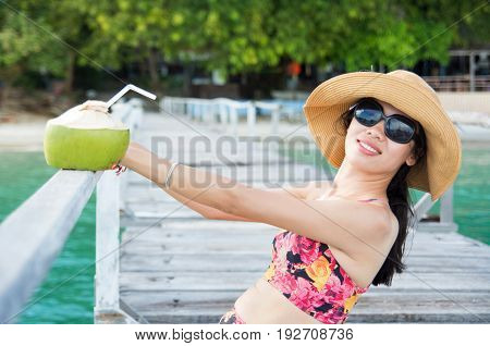 Woman With Coconut On Tropical Destination