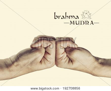 Brahma mudra. Yogic hand gesture. Isolated on toned background.