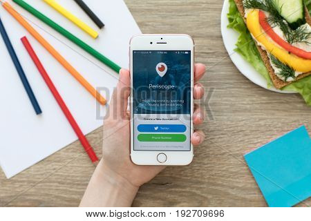 Alushta Russia - May 24 2017: Woman holding iPhone with client live video streaming Periscope on the screen. iPhone was created and developed by the Apple inc.