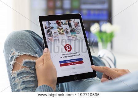 Alushta Russia - June 8 2017: Man holding iPad Pro Space Gray with social Internet service Pinterest on the screen. iPad Pro was created and developed by the Apple inc.
