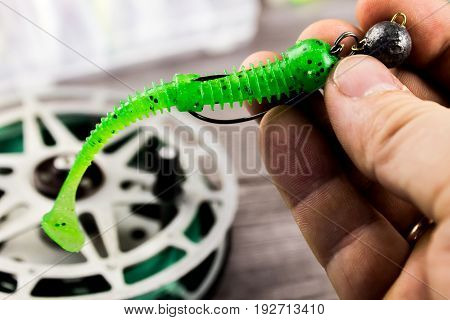 Fishing lure in the hand of fisherman