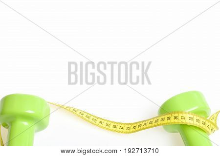 Green Dumbbells Connected To Each Other With Yellow Measuring Tape
