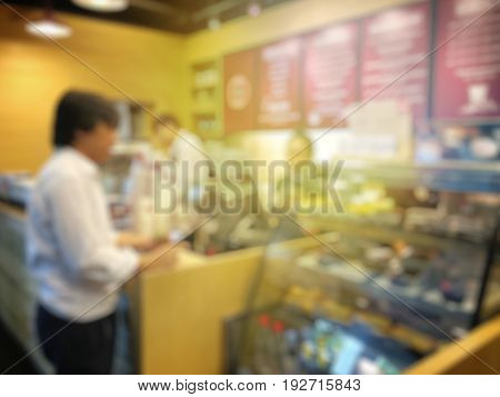 Blurred Image Of Businessman Queuing For Order Coffee In Coffee Shop Or Cafeteria ,customer At Resta