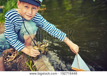A young boy dreams of becoming a sailor