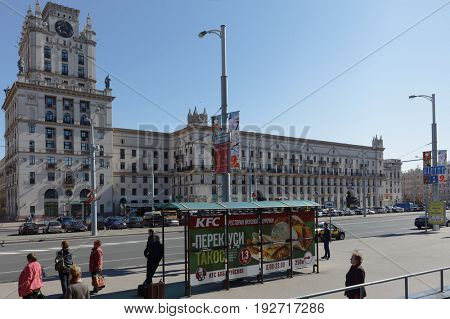 MINSK, BELARUS - MAY 14, 2017: Banner of KFC fast food restaurant against the Stalin Empire style buildings on Bobruyskaya street. First KFC opened in Belarus on October 2, 2015