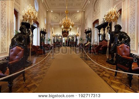 SINTRA, PORTUGAL - MAY 10, 2017: People in the hall of National Palace of Sintra. Since 1995, the cultural landscape of Sintra is listed as UNESCO World Heritage
