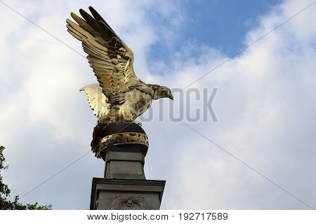 LONDON, GREAT BRITAIN - MAY 15, 2014: It is a gilded eagle that crowns the Battle of Britain monument on the Victoria Embankment.