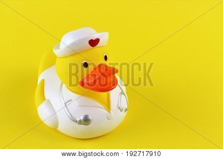 An image of a yellow duck infront of a yellow background
