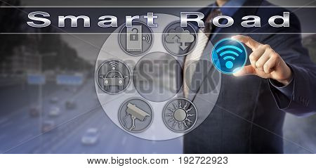 Blue chip traffic manager is incorporating a wireless network icon into a virtual Smart Road communication interface. Technology concept for mobility management and intelligent transportation system.