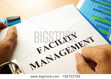 A folder with title Facility Management. Business concept.