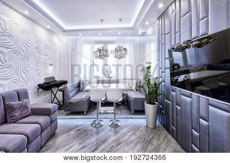 Modern design interior of living room in a luxury apartment in gray and white tones.