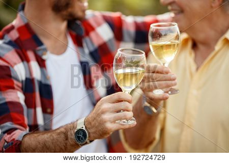 White wine in wineglass - successfully harvesting grapes