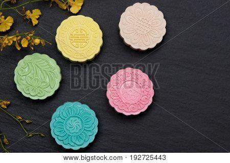 Sweet color of snow skin mooncake on dark background.