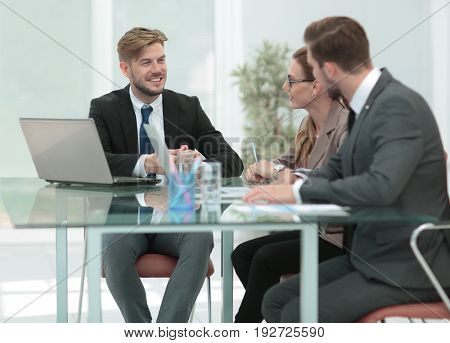 A group of successful business people. Discussion of the importa