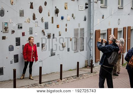 Tourists Walk On Literatu Street In Vilnius, Lithuania